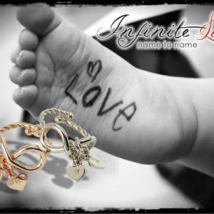Linea gioielli Infinite Love - Anello con cuoricini pendenti rutenio, palladio, rosè